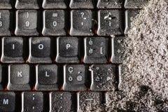 Buried black keyboard Stock Photos