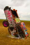 Buried Cadillac. Covered in grafitti at Cadillac Ranch in Amarillo, TX Stock Photo