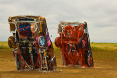 Buried Cadillacs. Covered in grafitti at Cadillac Ranch in Amarillo, TX Royalty Free Stock Photography