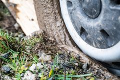 Buried car in the mud stock photography