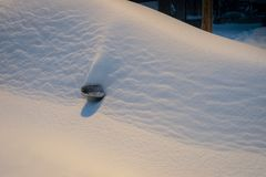 Buried car in street during snow storm in Montreal Canada stock photos