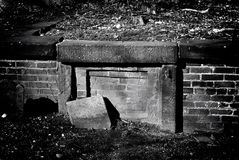 Buried crypt. Old early america grave stones in bostons granary cemetery, an old grave in front of a hlaf buried crypt stock images