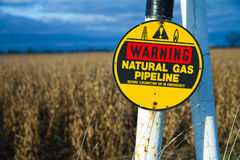 Buried gas pipeline. Warning natural gas pipeline placard marking explosive buried natural gas line. Pipeline may explode if dug into or hit
