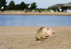 Buried head. In sand Royalty Free Stock Photo