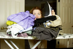 Buried in Ironing Royalty Free Stock Photography