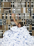 Buried in papers Royalty Free Stock Image