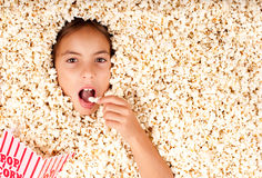 Buried in popcorn Royalty Free Stock Photography