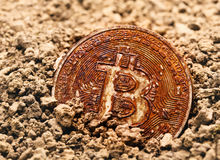 Buried rusty bitcoin stock images