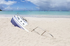 Buried sailboat stock images