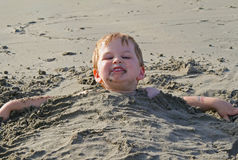 Buried in sand Royalty Free Stock Photo