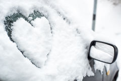 Buried by snow car with heart on side window Royalty Free Stock Images