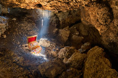 Buried Treasure. Cave with skylight streaming sunlight on a treasure chest Stock Image