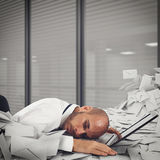 Buried by worksheets and spam Stock Photo