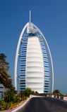 Burj Al Arab. Burj Dubai in the daytime set against a bright blue sky Stock Photography