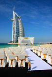 Burj Al Arab. Dubai - United Arab Emirates: 12 February 2010. A wedding on the beach in front of the iconic Burj Al Arab (Tower of the Arabs) Hotel. Standing 32m Royalty Free Stock Image