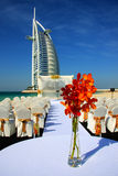 Burj Al Arab. Dubai - United Arab Emirates: 12 February 2010. A wedding on the beach in front of the iconic Burj Al Arab (Tower of the Arabs) Hotel. Standing 32m Royalty Free Stock Photo