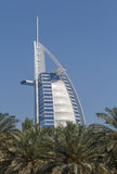 Burj al Arab behind palm trees Stock Photos