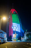 Burj al arab is covered with the national flag colo Stock Image