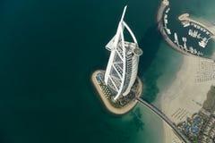 Burj al-Arab - Dubai, UAE. Dubai, UAE - November 25, 2012: View of the luxury beach of Dubai and Burj al-Arab, in Dubai, UAE. The Bur is the most exclusive hotel royalty free stock photo