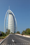 Burj Al Arab. DUBAI, UNITED ARAB EMIRATES, - FEB 05, 2014: Cityscape, view on Burj Al Arab is a luxury 7 stars hotel royalty free stock image