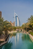 Burj Al-Arab Hotel Dubai  UAE. Tropical waterway with the Burj Al-Arab Hotel, the tallest hotel in the world, in the distance.  Dubai, United Arab Emirates Royalty Free Stock Image