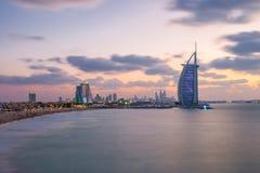 Burj Al Arab and Jumeirah Beach Hotel at the sunset Stock Photography