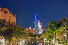 Burj Al Arab at night. Burj Dubai illuminated in various colours at night royalty free stock photo