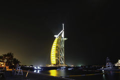 Burj al arab at night yellow Stock Images