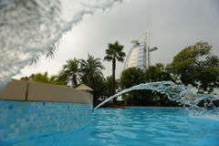 Burj Al Arab and pool. A pool with the Burj Al Arab in the background Royalty Free Stock Image