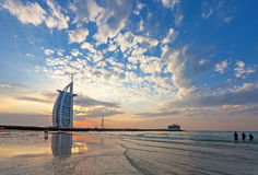 Burj Al Arab sunset. Jumeirah Beach beautiful clouds and blue sky in warm golden light Royalty Free Stock Images