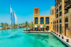 Burj al Arab view from Madinat Jumeirah, Dubai. Beautiful view on hotel sail. Market and walking area with a beautiful. View of the channels with sea water royalty free stock photos