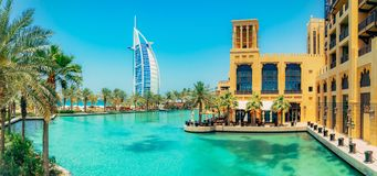 Burj al Arab view from Madinat Jumeirah, Dubai. Beautiful view on hotel sail. Market and walking area with a beautiful. View of the channels with sea water royalty free stock photo
