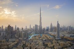 Burj Khalifa And Dubai Fountain Against The Sunset Stock Images