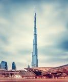 Burj Khalifa and Dubai's modern metro station. DUBAI, UAE - FEBRUARY 09: Burj Khalifa, world's tallest tower at 828m, located at Downtown, modern new metro stock images