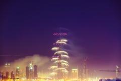 Burj Khalifa New Year 2016 fireworks. 2016 January 1, UAE, Dubai: Burj Khalifa New Year fireworks. Fire at The Address Hotel on January 1 in Dubai royalty free stock images