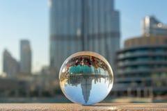 Burj Khalifa tower in Dubai through a crystal ball, UAE stock photography