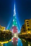 BUrj Khalifa Tower floodlit in the white, green and red colors. DEC 03 -DUBAI, UAE:  Burj Khalifa Tower floodlit in the white, green and red colours of the flag Stock Image