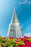 Burj Khalifa vanishing in blue sky in Dubai, UAE. Royalty Free Stock Images