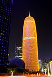 Burj Qatar in Doha at night. Famous landmark skyscraper Burj - Tower - Qatar in Doha at night. Built in 2005-2012; designed by French architect Jean Nouvel, has Royalty Free Stock Photo