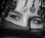 Burka. A black and white image of a woman wearing a burka with a mysterious expression through her eyes Stock Photos