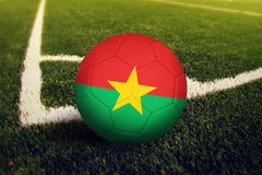 Burkina Faso ball on corner kick position, soccer field background. National football theme on green grass.  royalty free stock images