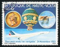 Plane. BURKINA FASO CIRCA 1978: stamp printed by Burkina Faso, shows Montgolfier, hot air balloon and memorial medal, circa 1978 stock photo