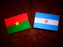 Burkina Faso flag with Argentinian flag on a tree stump isolated Royalty Free Stock Photo