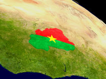 Burkina Faso with flag on Earth Stock Photo