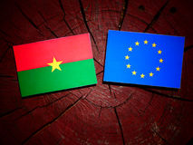 Burkina Faso flag with EU flag on a tree stump isolated Stock Photography