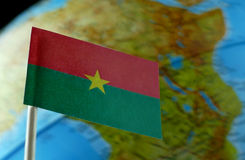 Burkina Faso flag with a globe map as a background Royalty Free Stock Image