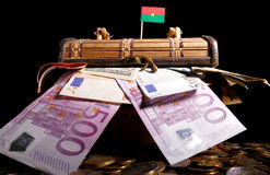 Burkina Faso flag on top of crate. Full of money stock image