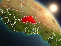 Burkina Faso från utrymme under soluppgång Royaltyfria Foton