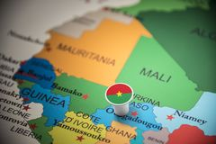 Burkina Faso marked with a flag on the map.  royalty free stock photography