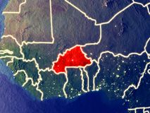 Burkina Faso na terra na noite imagem de stock